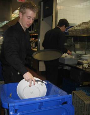 Restaraunt worker separating food scraps